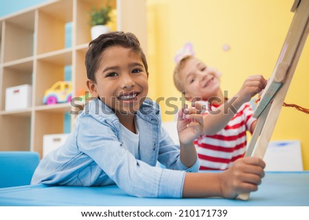 Cute little boys making art in classroom at the nursery school - stock photo