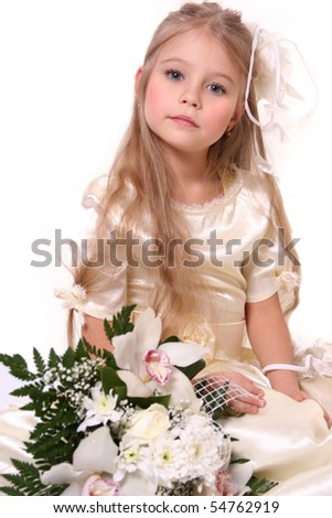 cute little bridesmaid with bunch of flowers - stock photo
