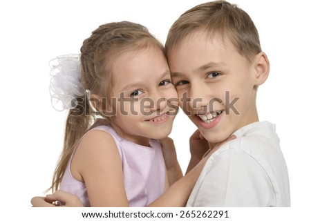 Cute little brother and sister hugging on white background - stock photo