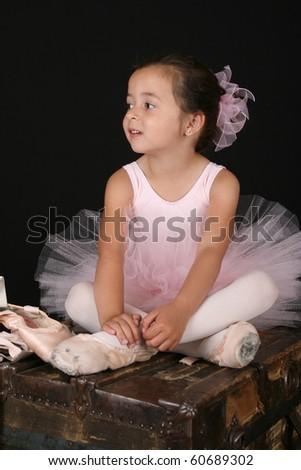 Cute little brunette girl in a pink ballet costume - stock photo