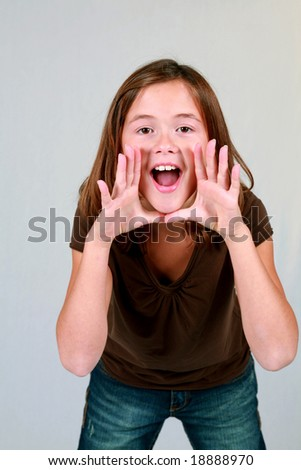 cute little brunette girl with hands by mouth shouting - stock photo