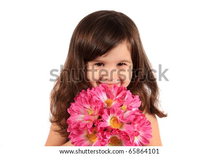 Cute little brunette three year old girl holding and hiding behind flowers and smiling on a white background - stock photo