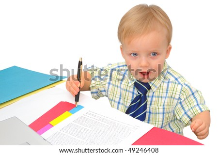 Cute little businessman is signing a contract - stock photo