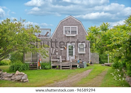 Cute little cedar shakes bungalow style house in Kennebunkport Maine. - stock photo