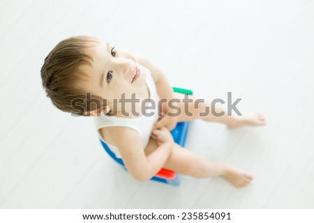 Cute little child at home toilet - stock photo
