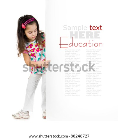 cute little child behind a white board - stock photo