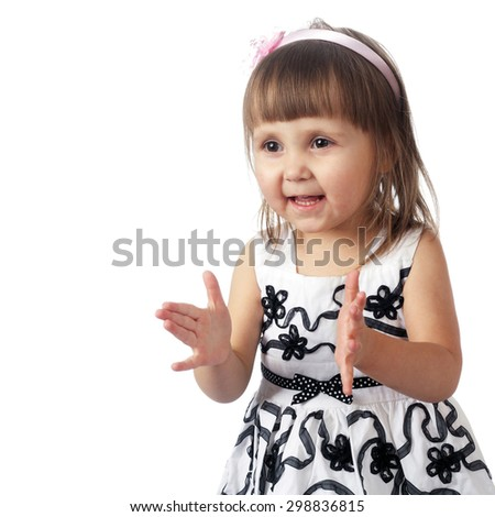 cute little child clapping her hands - stock photo