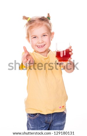 Cute little child holding glass with juice smiling isolated on white - stock photo