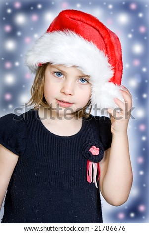 Cute Little Child in Santa Hat with Festive Background