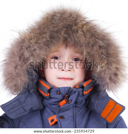 cute little child in the winter fur clothing - stock photo