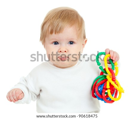 Cute little child is playing with colored toys, isolated over white - stock photo