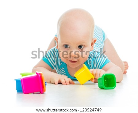 Cute little child is playing with toys isolated over white - stock photo