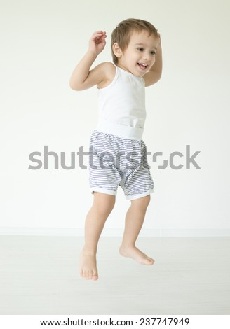 Cute little child jumping at home