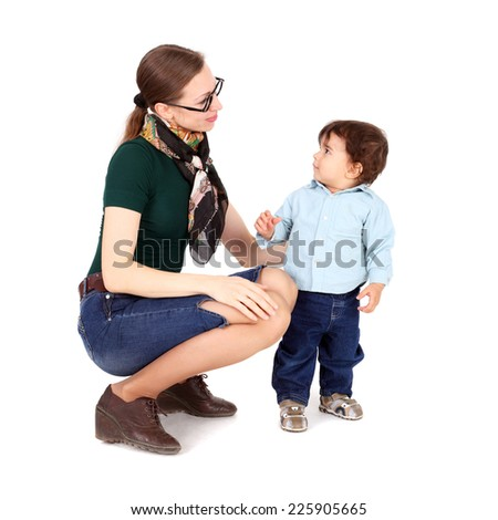 cute little child looking surprised at his mother - stock photo