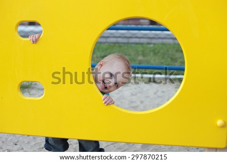 cute little child playing on the playground outdoors - stock photo