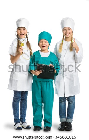 Cute little children dressed like doctor looking at camera with  cheerful smile isolated on white background. medicine concept - stock photo