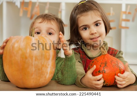Cute little children having fun for Halloween