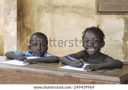 Cute Little Children Learning with Pens and Paper in Africa (Schooling Education Symbol) - stock photo