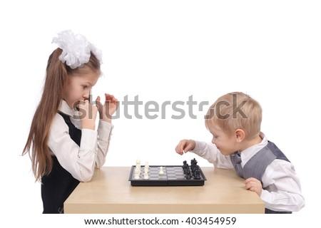cute little children playing chess - stock photo