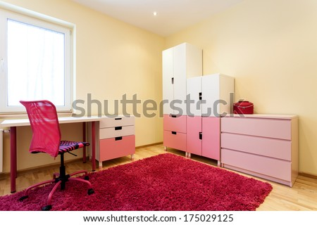 Cute little children room with pink soft carpet for girls - stock photo