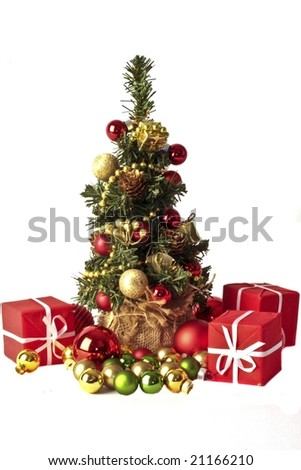 Cute little christmastree with presents and ornaments - stock photo