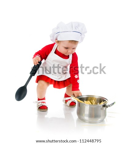 Cute little cook girl with a big spoon  on a white background - stock photo