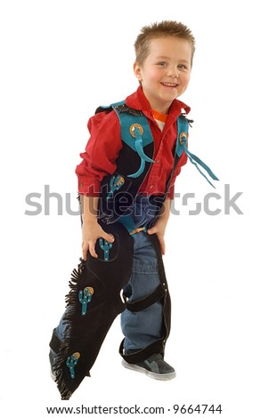 Cute little cowboy in colorful chaps - stock photo