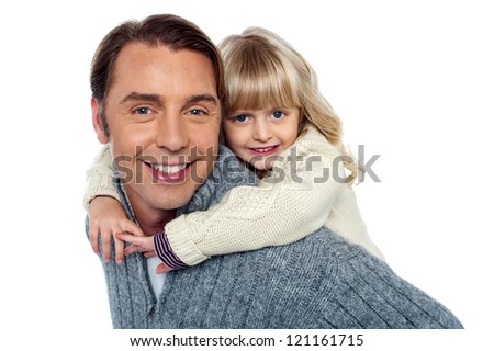 Cute little daughter piggybacking her father. Both having fun.