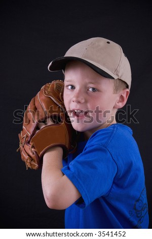 Cute little eight year old boy ready for baseball practice. - stock photo