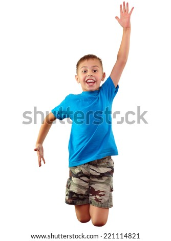 Cute little elementary boy exercising and jumping. Isolated over white background.