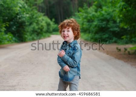 cute little emotional boy outdoors - stock photo