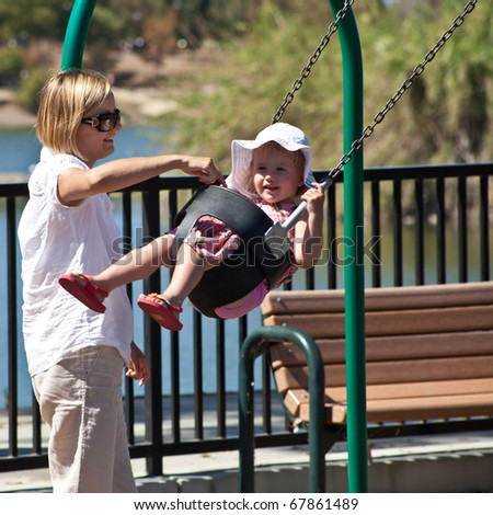 Cute little European toddler girl having fun at the playground in park - stock photo