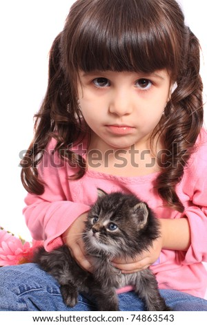 Cute little four year old girl in pigtails holding a little kitten on a white background - stock photo
