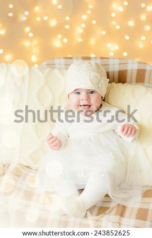 Cute little girl  against warm soft Christmas lights - stock photo