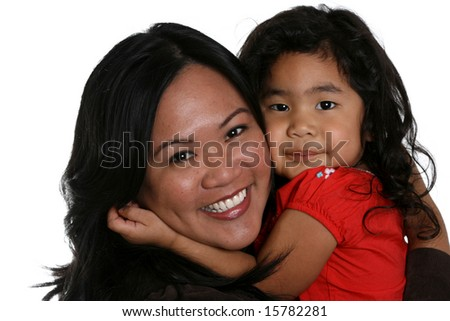 cute little girl and attractive young woman hugging tightly
