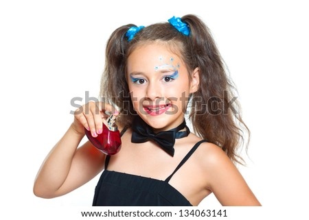 cute little girl and perfume - stock photo
