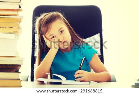 Cute little girl as a businesswoman - stock photo