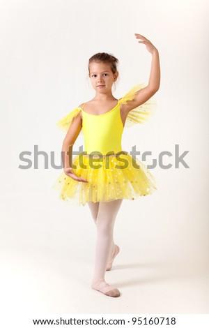 Cute little girl as ballet dancer, studio shot on white background - stock photo