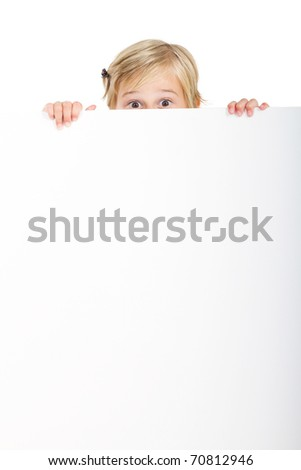 cute little girl behind white board with funny facial expression - stock photo