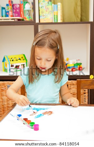 cute little girl coloring in her room - stock photo