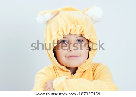 Cute little girl costumed as yellow bear  - stock photo