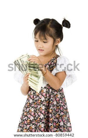 cute little girl counting money over white - stock photo