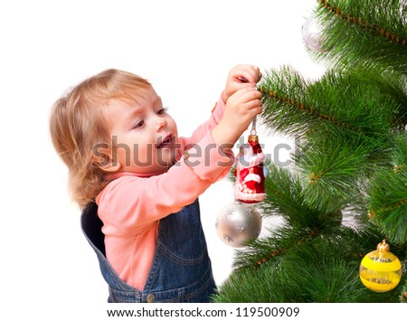 Cute little girl decorates the Christmas tree. Isolated on white - stock photo