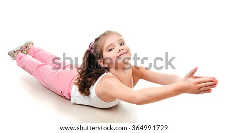 Cute little girl doing gymnastic exercise isolated on a white