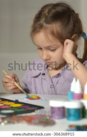 Cute little girl drawing at home close-up
