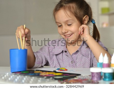 Cute little girl drawing at home close-up - stock photo