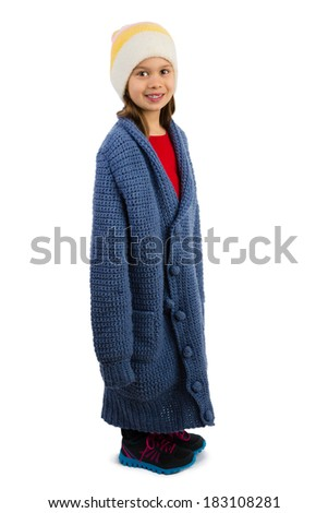 Cute little girl dressed in oversized cardigan buttonned in a wrong way, isolated - stock photo