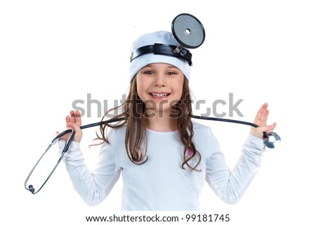 Cute little girl dressed like a doctor looking at camera with a cheerful smile - stock photo