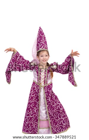 cute little girl dressed like a witch