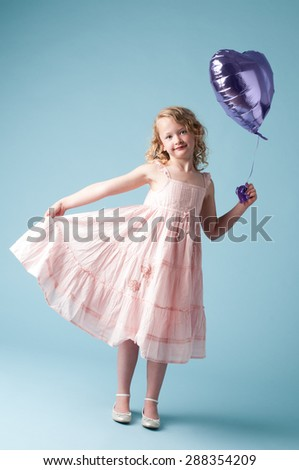 Cute little girl dressed up for a party - stock photo